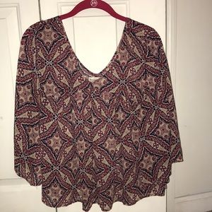 Blouse with three-quarter length sleeves.